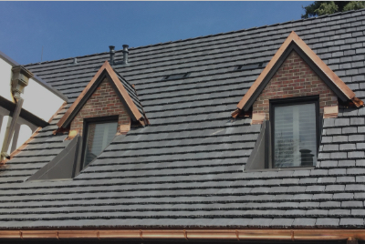 residential roof with two windows and grey roof